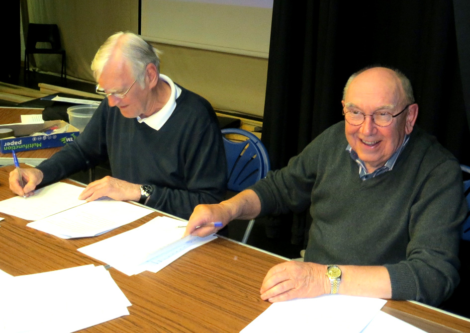 Trevor and Colin, marking the answer papers